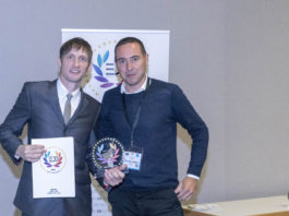 Scott More, Chief Technology Officer and Co-founder of Tilia Labs Inc., receives the EDA Award for workflow technology from Lorenzo Villa of Italia Publishers.